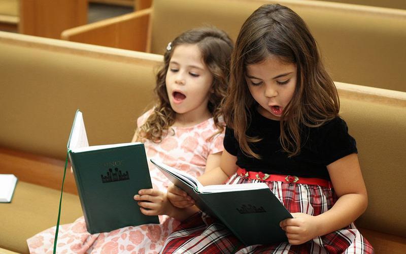 Two little girls singing