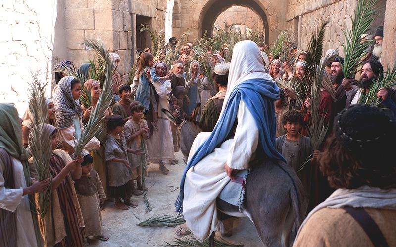 Gesù che entra nel paese su un asino