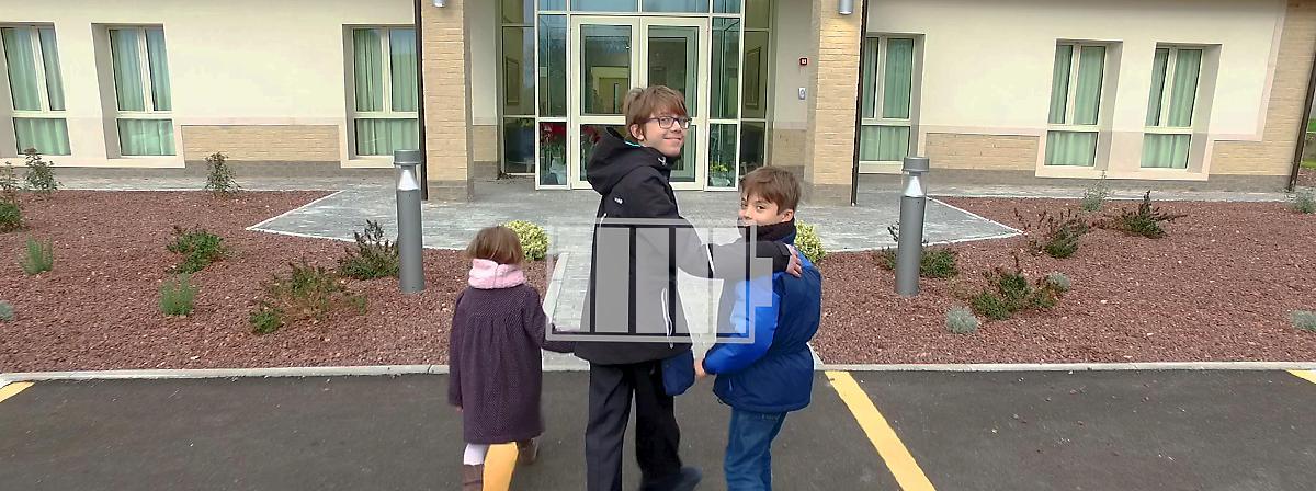 kids enter a church building