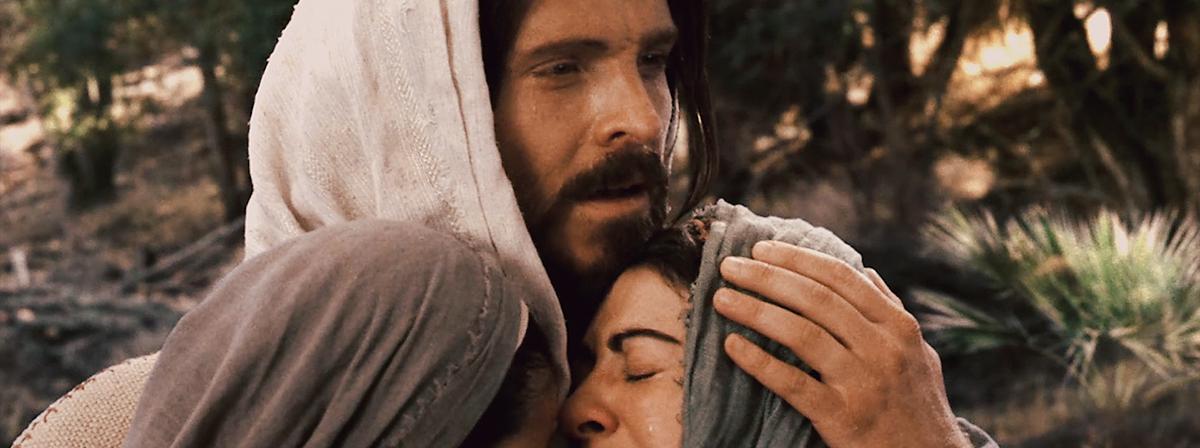 Jezus Christus omhelst een huilende vrouw.