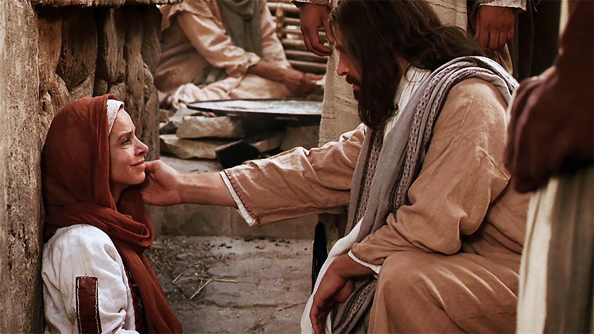 Kristus sträcker sig ut för att trösta kvinnan som hade tro.