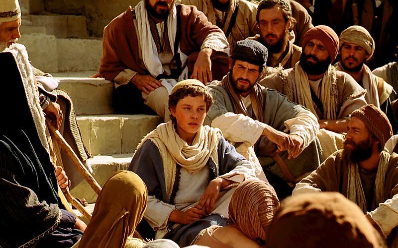 Um jovem Jesus Cristo ensina no Templo.