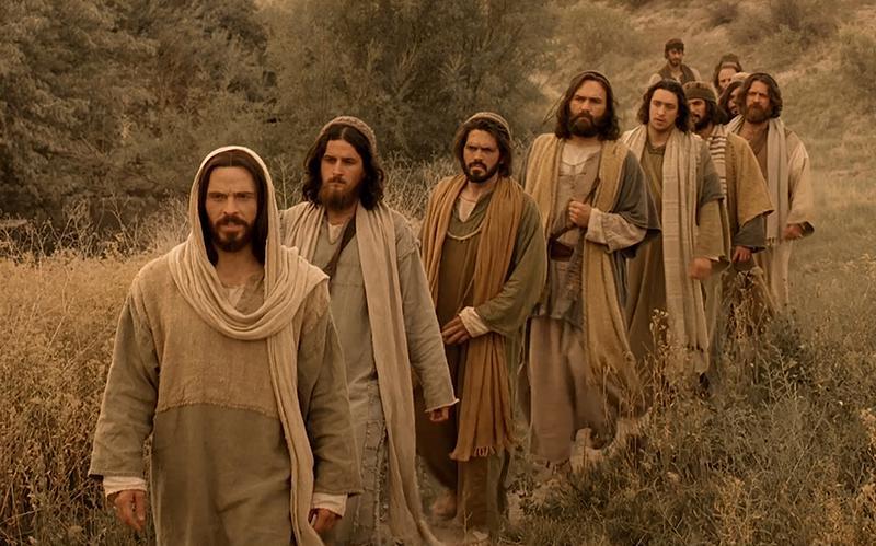 Jesus Christ leading his disciples.