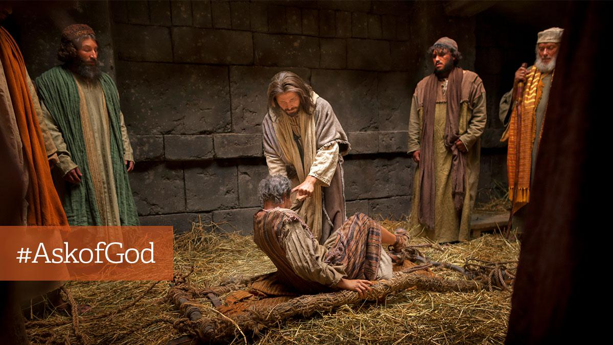 Jesus Kristus løfter mand op fra leje