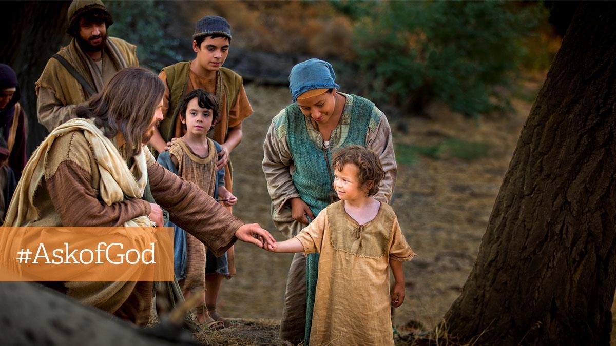 Jesus Kristus holder barns hånd