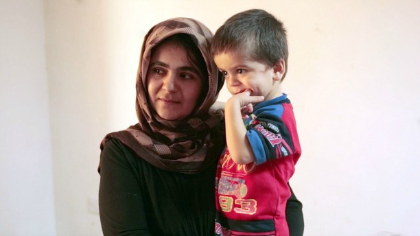 PSD150915_GB-Refugees-mom-son.jpg