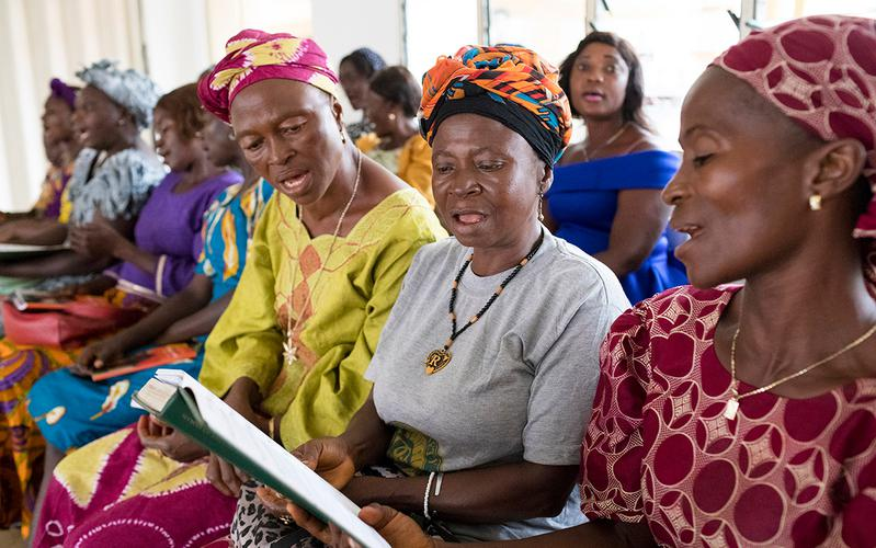 women singing hymns at church
