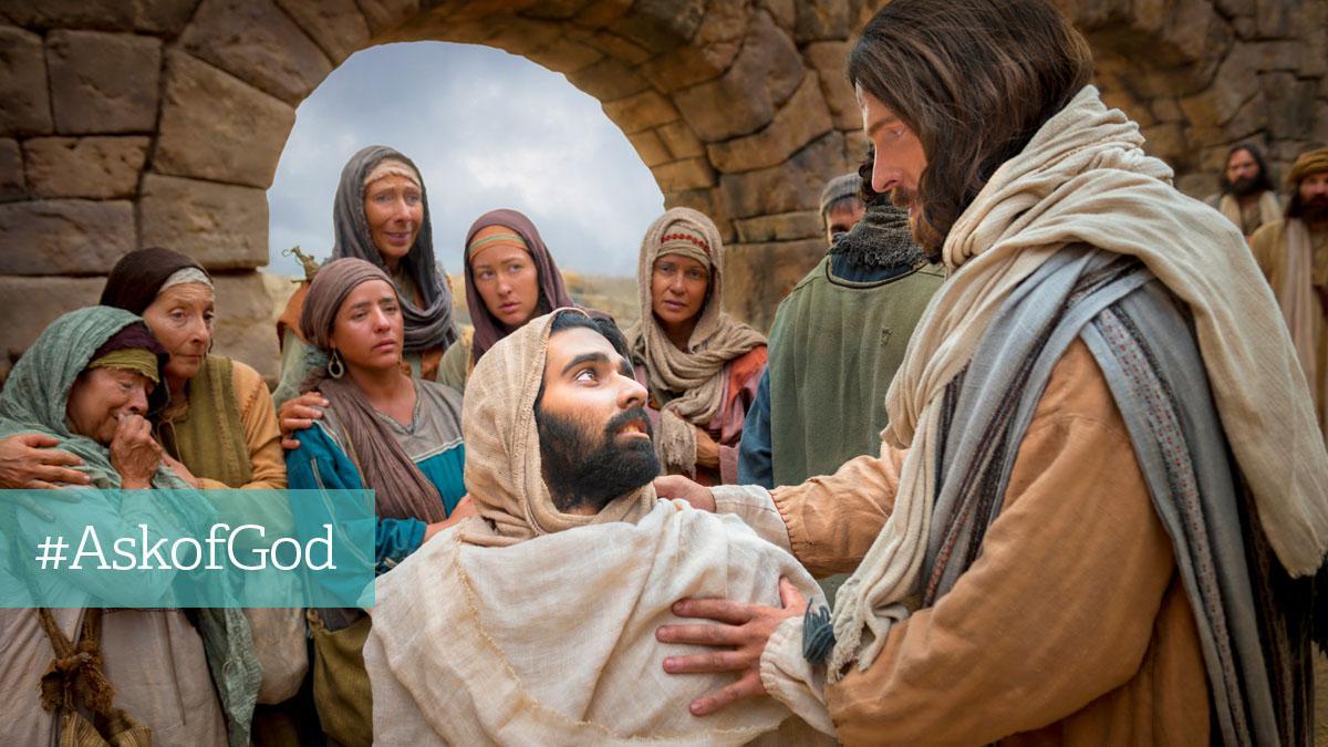 Jesus holder om mand i folkemængde