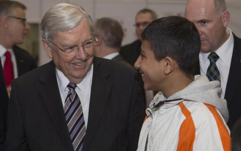 Elder Balllard engages with young refugee