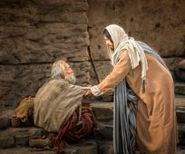 jesus-helps-up-man