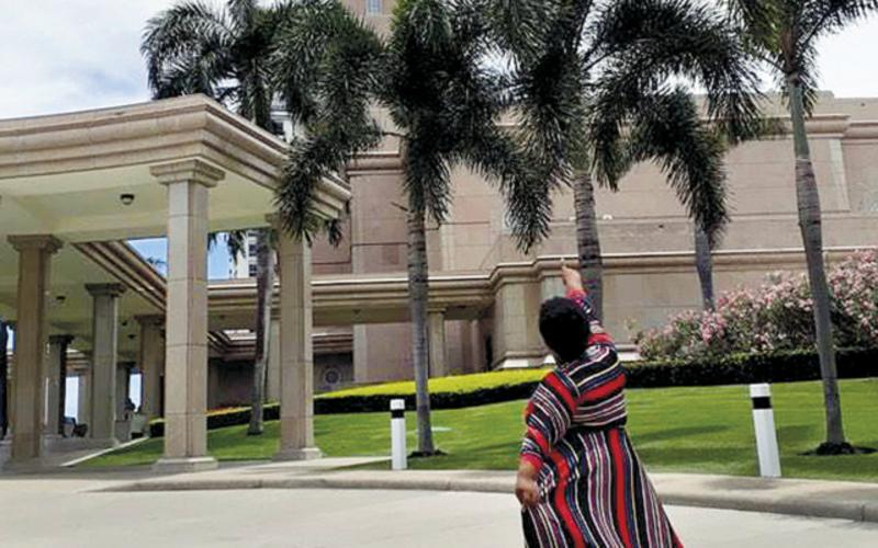 ramona_temple_pointing_palm_trees
