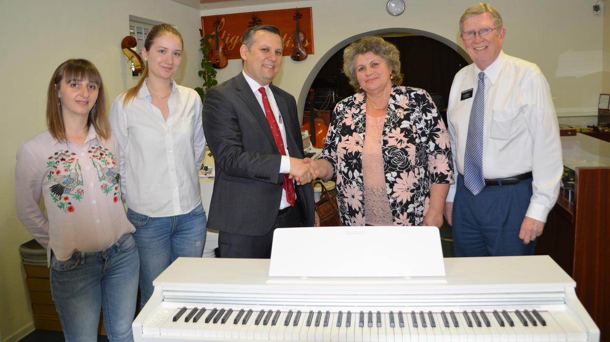 Church_presents_piano_gift