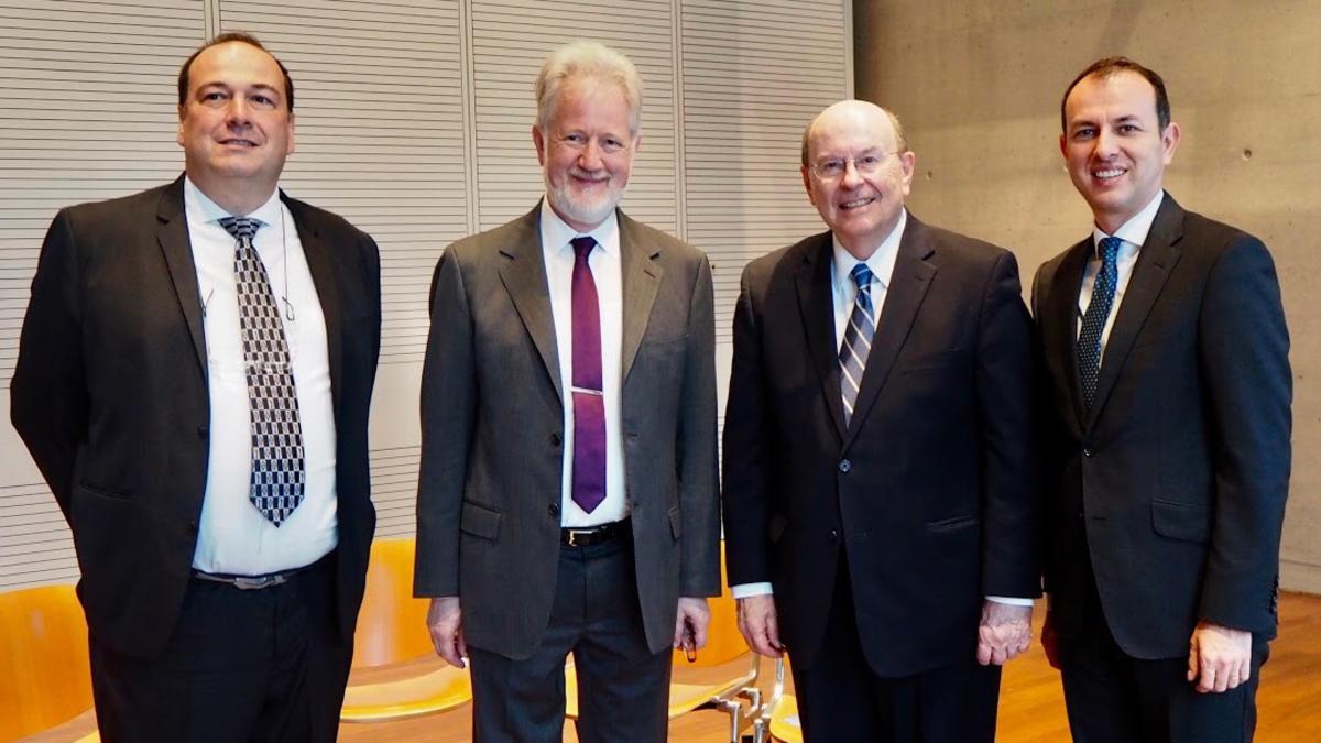 four men in suits
