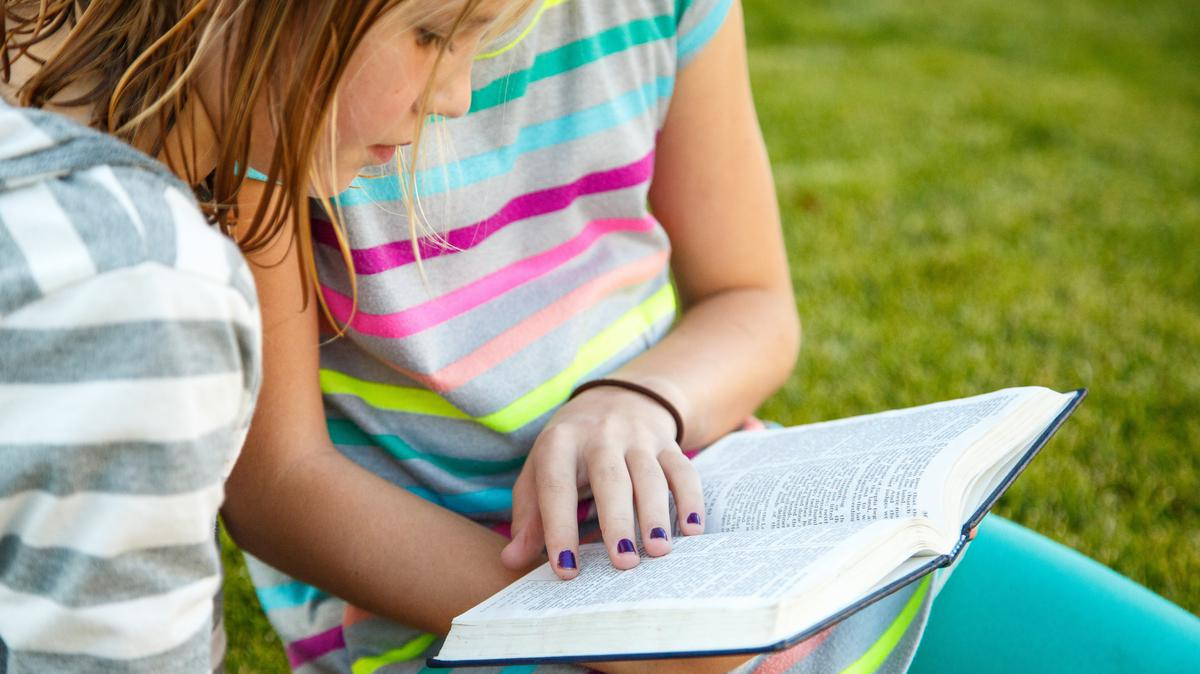 Girls reading the scriptures