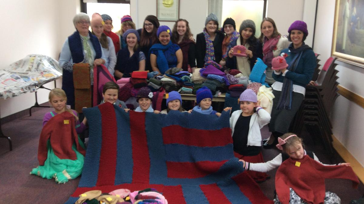 Sisters of the Newcastle Emlyn Ward with the knitted items for refugees