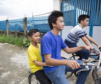 philippines-family-walking-biking-dirt-road-1343510-print.jpg
