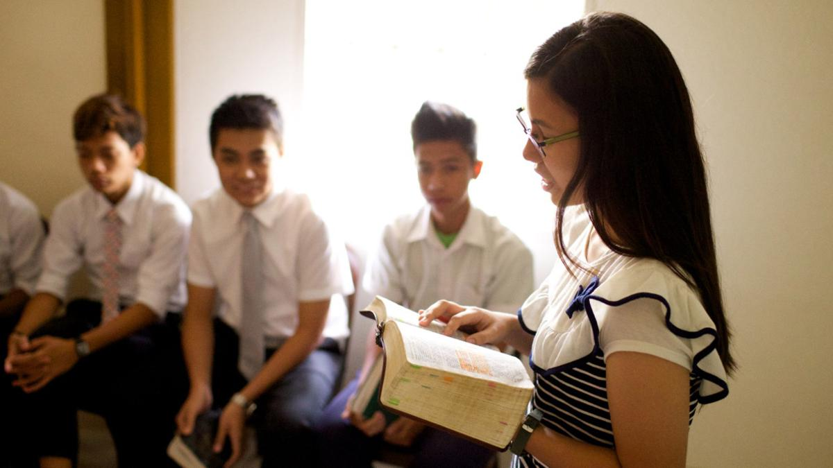 A student reads from the scriptures.