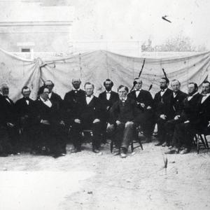 Front row, left to right: George A. Smith, Brigham Young, Daniel H. Wells. Back row: Orson Hyde, Orson Pratt, John Taylor, Wilford Woodruff, Ezra T. Benson, Charles C. Rich, Lorenzo Snow, Erastus Snow, Franklin D. Richards, George Q. Cannon, Brigham Young Jr., Joseph F. Smith. (Used by Permission, Utah State Historical Society, Salt Lake City. Photograph by Charles R. Savage.)