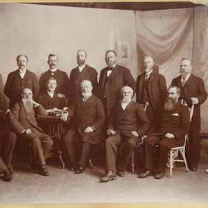 Seated, left to right: Joseph M. Tanner, George Goddard, John M. Whitaker, George Q. Cannon, Karl G. Maeser, George Reynolds. Standing: Levi W. Richards, John C. Cutler, Abraham H. Cannon, Heber J. Grant, Francis M. Lyman, Thomas C. Griggs, Joseph W. Summerhays. (Church History Library, Salt Lake City. Photograph by Charles R. Savage.)