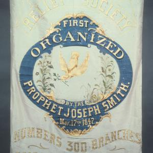 The Central Board of the Relief Society rode in carriages behind this white silk banner for the Jubilee Pioneer Day celebration in Salt Lake City in 1880. (Church History Museum, Salt Lake City.)