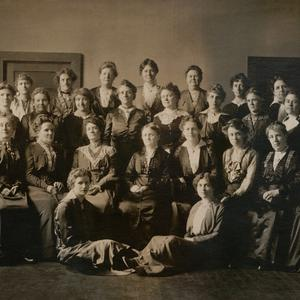 Circa 1905. The first YLMIA general board was organized in 1880 under Elmina S. Taylor. The board members traveled, coordinated the efforts of local associations, corresponded with local units, conducted training, developed curriculum and programs, and spoke at MIA June Conferences starting in 1896. Included in this photo are the following women who are mentioned in <i>At the Pulpit:</i> Maria Y. Dougall (seated row, first on right), Emma N. Goddard (seated row, second from right), Ann M. Cannon (seated row, third from right), Mattie Horne Tingey (seated row, fifth from right), Ruth May Fox (seated row, sixth from right), May Booth Talmage (first standing row, fifth from right), and Minnie J. Snow (second standing row, first on right). Tingey was YLMIA general president at the time this photo was taken.