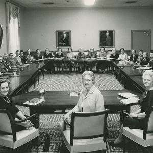 1962. With members of the presidency at the head of the table (left to right: Madsen, Spafford, and Sharp), the Relief Society general board poses in the six-year-old Relief Society Building. Board members trained Relief Society units throughout the world, oversaw temple clothing production, published the <i>Relief Society Magazine,</i> and created Relief Society curriculum.