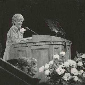 Shown speaking at general women's meeting, 1983. A writer, editor, and television and radio personality, Cannon actively endorsed the creation of a magazine for young people in the church and served as an associate editor when the <i>New Era</i> began publication in 1971. She also petitioned for young women to have Sunday religious instruction in addition to their weekday meetings. The church adopted this policy in 1980 while she was Young Women general president.