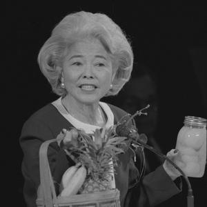 Shown delivering a general conference address, 1996. Okazaki was a prolific writer and popular speaker. A former elementary school teacher and principal, she frequently employed visual aids when she spoke.