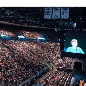 2016. The Marriott Center holds plenary sessions of BYU Women's Conference, which began in 1976. The image of Sandra Rogers, international vice president of BYU,  appears on the large screen.