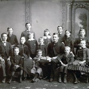 23 June 1884. Seated, left to right: Amelia Cannon, William T. Cannon, Read T. Cannon, Mary Alice Cannon, Joseph J. Cannon, Sander Saunders (teacher), Brigham T. Cannon, Hester Cannon. Standing: Charlie Davey Cannon, David H. Cannon, Hugh J. Cannon, Sylvester Q. Cannon, Willard T. Cannon, Emily Cannon, Angus J. Cannon, Rosannah Cannon, Lewis T. Cannon. (Church History Library, Salt Lake City. Photograph by Charles R. Savage.)