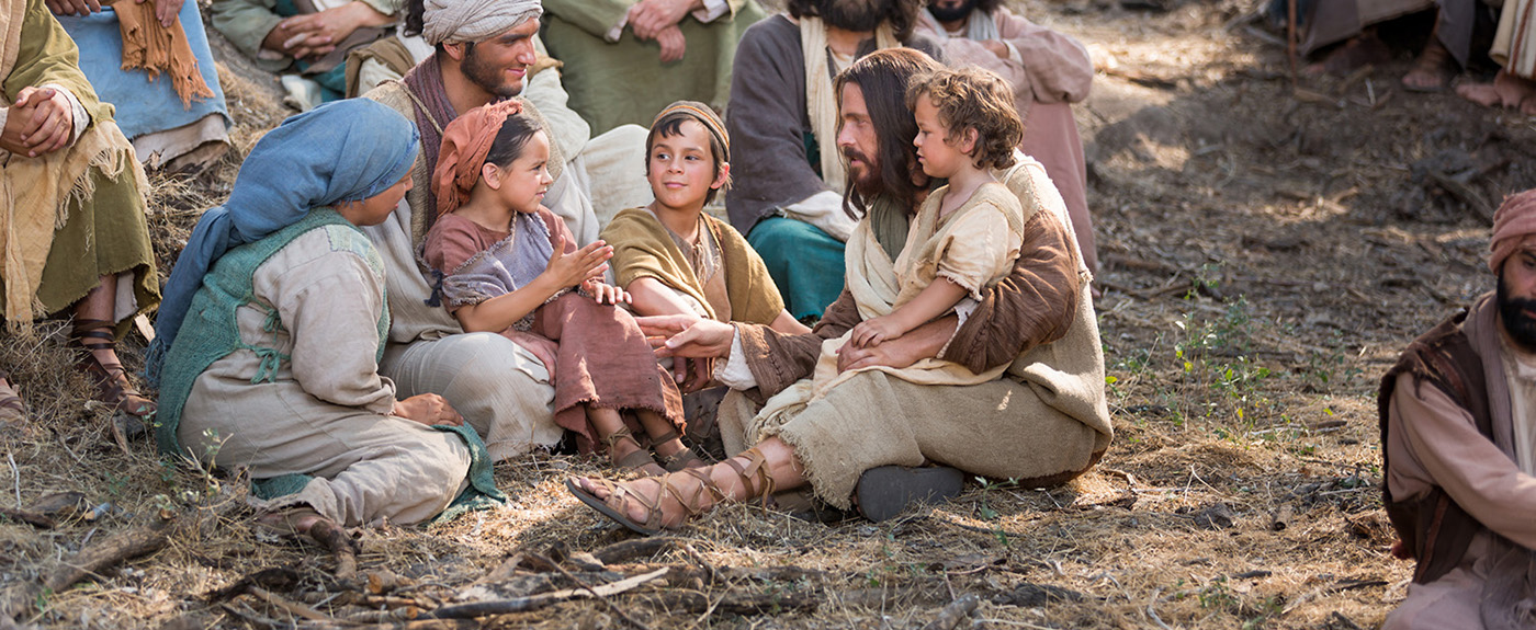 the Savior sitting and talking with children