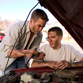 youth working on a car