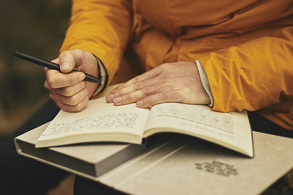 Hands with a journal