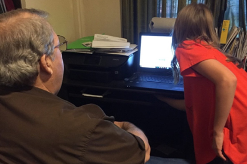 My 12-year-old teaching her grandpa how to find family on FamilySearch.