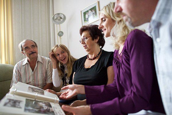 Family looking at a photo album