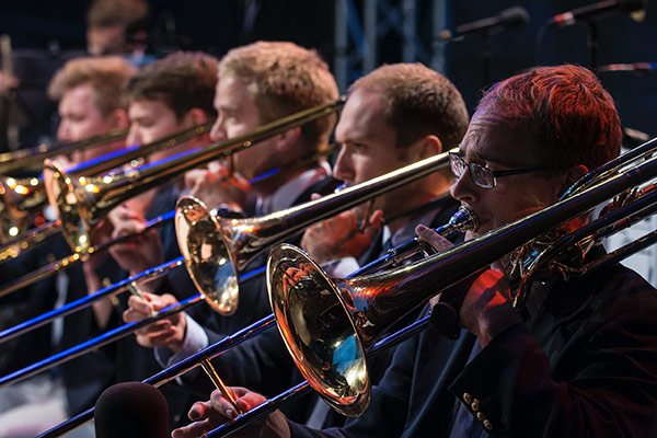 Men playing trombones