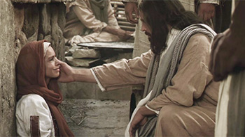 Jesus touching a woman's face
