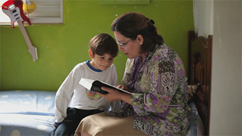 Woman reading to boy