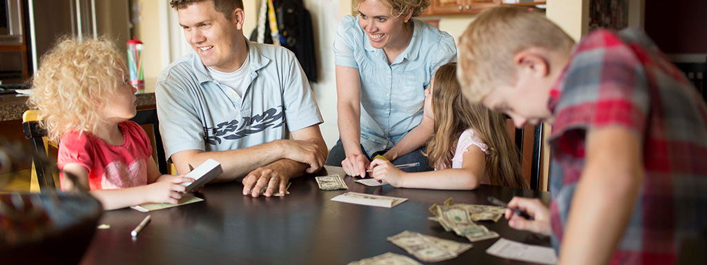 Family looking at money