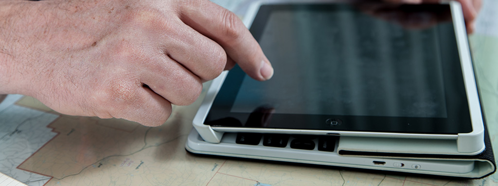 Hands on a tablet