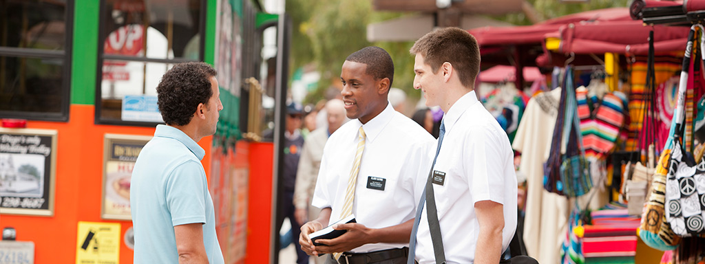 Missionaries tracting