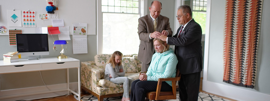 Woman receiving a priesthood blessing