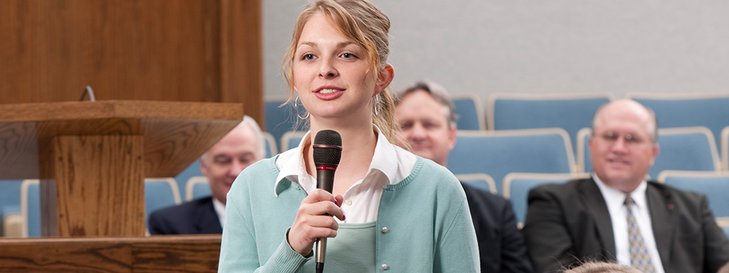 Girl holding a microphone