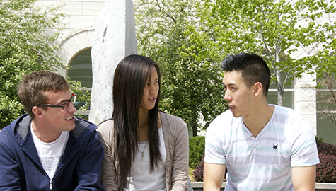 youth talking on a campus