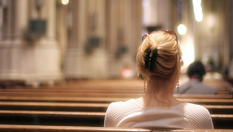 woman sitting in a chapel