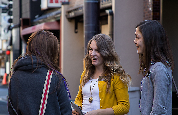 young women talking on the street