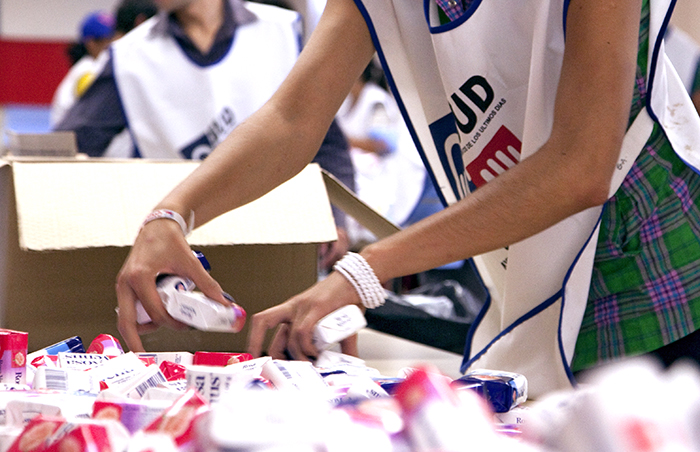workers assembling care packages