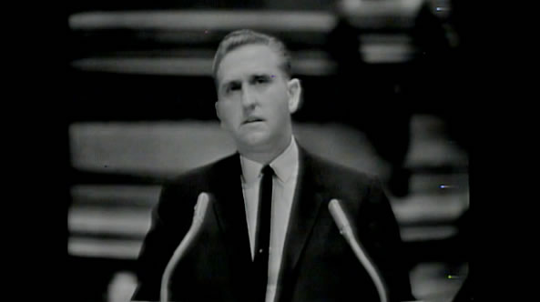 Black and white pulpit shot of Thomas Monson
