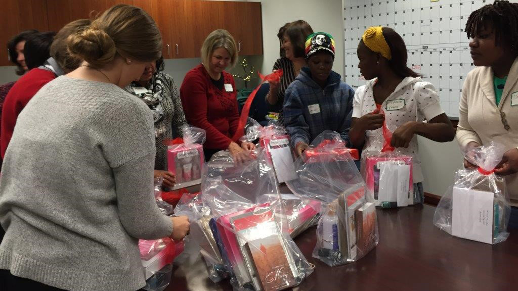 The Relief Society general board and refugee women help compile kits for women in need at the Granite Refugee Cente