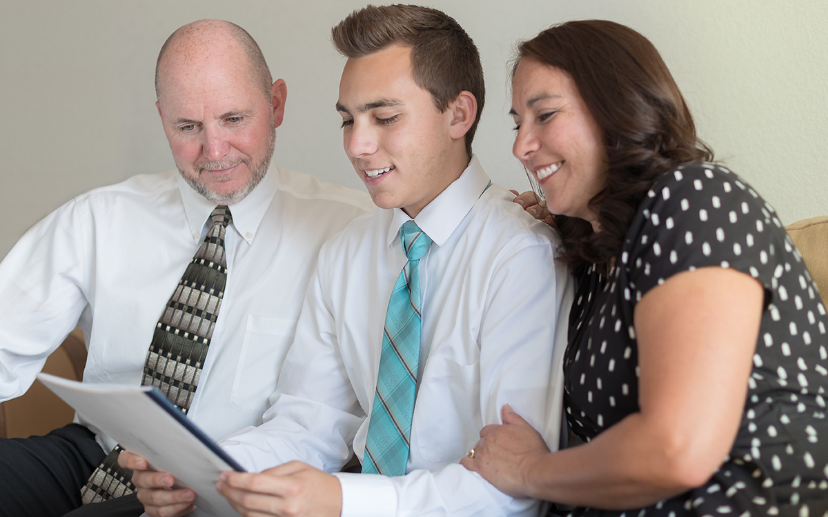 Missionary and parents reading mission call
